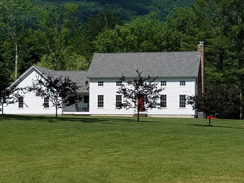 The residence at Inn at Manchester. A large white historic home.